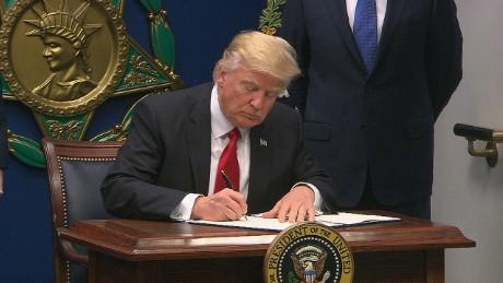 170130171650-trump-refugee-ban-signing-large-169